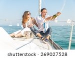 couple celebrating with... | Shutterstock . vector #269027528