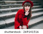 girl in red coat on the stairs | Shutterstock . vector #269141516