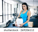 happy woman holding plastic... | Shutterstock . vector #269206112