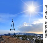 mast on the top in the mountains - stock photo