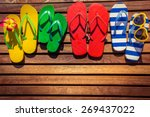 multicolor flip flops on wooden ...