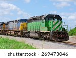 Green Freight Train Pulling A...