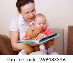 happy mother is reading book