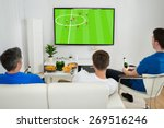 three men sitting on couch... | Shutterstock . vector #269516246