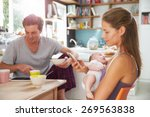 family with baby girl use... | Shutterstock . vector #269563838