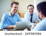 cheerful businessmen listening... | Shutterstock . vector #269584586