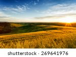 sunrise over a wavy field ... | Shutterstock . vector #269641976