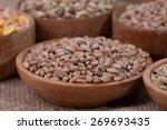 barley beans in wooden plate.... | Shutterstock . vector #269693435