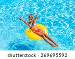 happy child on inflatable ring... | Shutterstock . vector #269695592