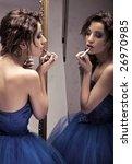 pretty brunette doing make up... | Shutterstock . vector #26970985