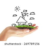 house in human hands symbol | Shutterstock . vector #269789156