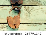 Old Rusty Padlock On Wooden...