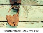 Old Rusty Padlock On Wooden...