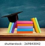 graduation  mortar board  book. | Shutterstock . vector #269843042