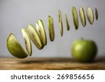 Levitating Sliced Green Apple