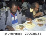 Two Black Men Eating Christmas...