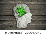 Stock photo puzzle head solution concept as a human face profile made from crumpled white paper with a jigsaw 270047342