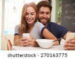 young couple eating breakfast... | Shutterstock . vector #270163775