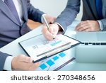 two businessmen looking at... | Shutterstock . vector #270348656