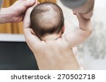 baby tries to sit down with the ... | Shutterstock . vector #270502718