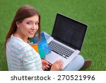 young woman with laptop sitting ... | Shutterstock . vector #270521996