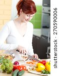 smiling young woman cutting... | Shutterstock . vector #270590006