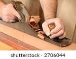 Traditional woodworker using a no7 steel jointer plane on a block of mahogany. - stock photo