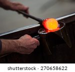 Glass Blower At Work Shaping...