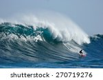 a surfer catches a huge wave. | Shutterstock . vector #270719276