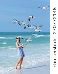 Young Woman Feeding Seagulls O...