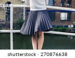 a young woman wearing a skirt... | Shutterstock . vector #270876638