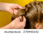 mother braiding french braid... | Shutterstock . vector #270940142