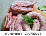 raw sausages on wooden table | Shutterstock . vector #270980318