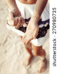 woman hands holding sand on the ... | Shutterstock . vector #270980735