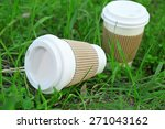 paper cups on green grass... | Shutterstock . vector #271043162