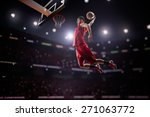 Red basketball player in action ...