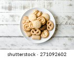 Butter Cookies in white ceramic dish on wood table
