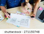 two web designers brainstorming ... | Shutterstock . vector #271150748