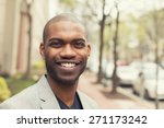 Small photo of Headshot portrait of young man smiling isolated on outside outdoors background.