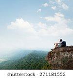 hiker relaxing on the rock | Shutterstock . vector #271181552