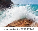 Wave And Splashes On Beach Of...