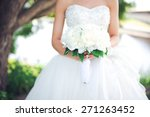 white bouquet in hands of the... | Shutterstock . vector #271263452