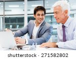 two businessmen in fornt of