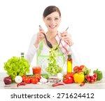 happy housewife preparing salad ...