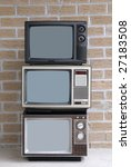Stack of three TV sets - stock photo