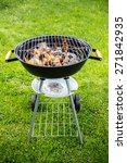 empty grill with fire on garden | Shutterstock . vector #271842935