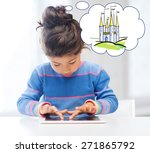 Small photo of technology, childhood, entertainment and imagination concept - little girl playing with tablet pc computer and thinking about fairytale castle at home