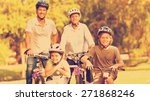 family with their bikes in a... | Shutterstock . vector #271868246