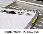 photo of a white laptop  a... | Shutterstock . vector #271869458