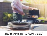 stack of plates on a table... | Shutterstock . vector #271967132